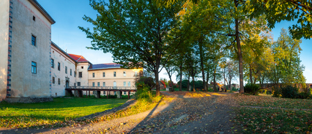 Uzhhorod, Ukraine - OCT 12, 2008: panorama of Uzhhorod castle inner courtyard. bridge and entrance to castle. beautiful park in evening light Stock Photo - 108887105