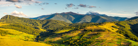 panorama of mountainous rural area in autumn. wonderful countryside with agricultural fields on hills. gorgeous Borzhava ridge in the distance Stock Photo - 108882766