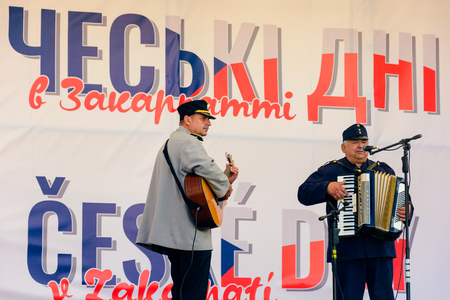 Uzhgorod, Ukraine - SEP 29, 2018: Czech days in TransCarpathia festival. 100 year of Czechoslovakia celebration. folk group play music. location Narodna Square.