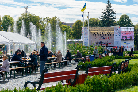Uzhgorod, Ukraine - SEP 29, 2018: Czech days in TransCarpathia festival. 100 year of Czechoslovakia celebration. people enjoy beer and snacks while listen to folk music. location Narodna Square