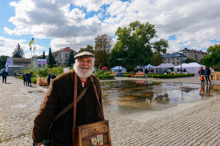Uzhgorod, Ukraine - SEP 29, 2018: Czech days in TransCarpathia festival. people enjoy celebration of 100 year of Czechoslovakia declaration. Man with barrel organ smiling Editorial