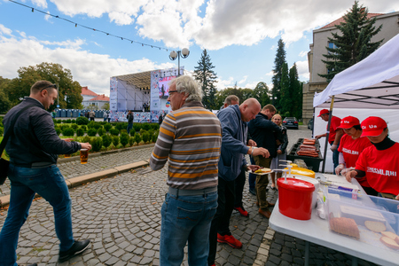Uzhgorod, Ukraine - SEP 29, 2018: Czech days in TransCarpathia festival. 100 year of Czechoslovakia celebration. people enjoy sausages, beer and other tasty snacks