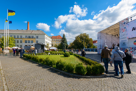 Uzhgorod, Ukraine - SEP 29, 2018: Czech days in TransCarpathia festival. 100 year of Czechoslovakia celebration. people enjoy listen to folk music. location Narodna Square. Ukrainian and European flag in the distance Editöryel