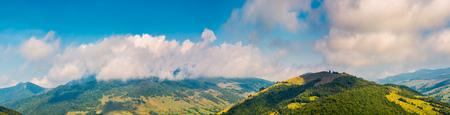 wonderful mountainous panorama in autumn. gorgeous cloudscape over the mountain Stock Photo