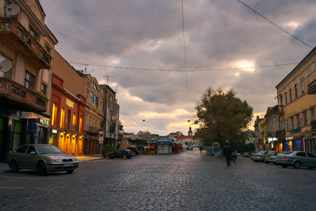 Uzhgorod, Ukraine - SEP 28, 2008: Petefi square on a cloudy autumn sunrise. old town awaiting for tourists crowds Editorial