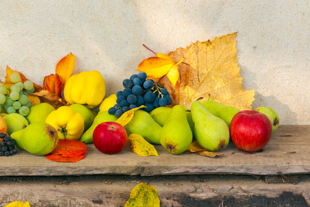 autumn harvest background. lots of fruits on the wooden desk Stock Photo - 109273746