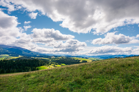 wonderful mountainous countryside in early autumn. beautiful sky. exploration and adventure concept Stock Photo