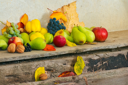 autumn harvest background. lots of fruits on the wooden desk Stock Photo - 109273794