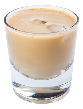 irish cream alcohol cocktail with ice in a short glass. isolated on a white background