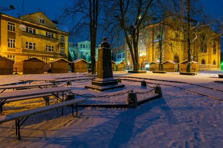 Uzhgorod, Ukraine - DEC 26, 2016: Feczik Park in winter at dawn. former building of synagogue is a popular tourist attraction. location for Christmas fair in town Editorial
