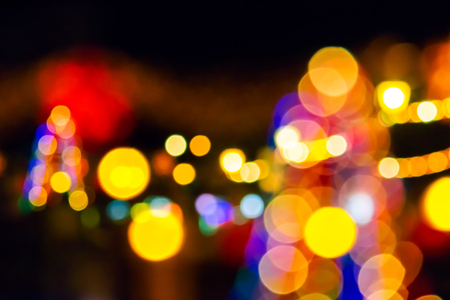 abstract composite of Christmas street lights at night