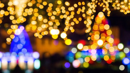 new year in the town concept. two Christmas trees and street lights. abstract composite blurry background.