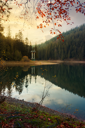 Autumn scenery of Synevyr lake. gorgeous evening light