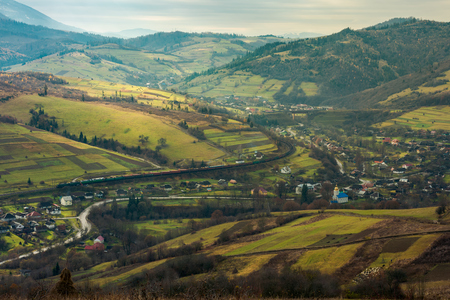 village in the valley. bird eye view. rail road and viaduct in the distance. mysterious autumn weather Stock Photo