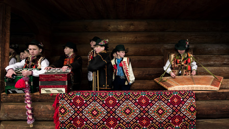 Uzhgorod, Ukraine - Jan 13, 2018: Vasylya festival celebrating in Museum of Folk Architecture and Life. Hutsul kids from Rakhiv region prepare for performance