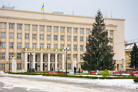 Uzhgorod, Ukraine - JAN 9, 2017: Christmas tree in the city center. Lovely postcard of Regional Administration building on Narodna square Editorial