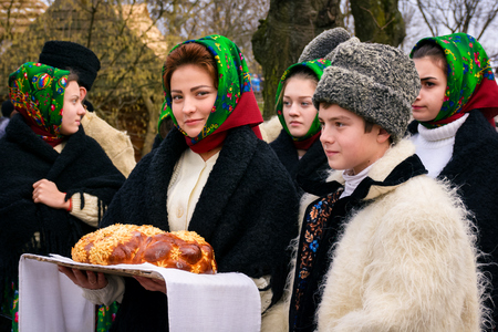 Uzhgorod, Ukraine - Jan 13, 2018: Vasylya festival celebrating in Museum of Folk Architecture and Life. local Romanians waiting for governor with traditional bread and salt