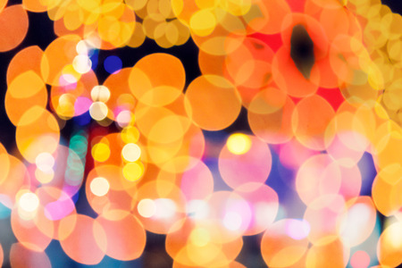 abstract christmass background. defocused city light. double exposure with new year tree Stock Photo