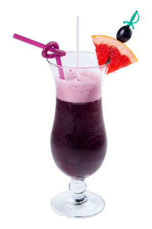 grape juice decorated with grapefruit. purple drink in a tall glass decorated with slice of fruit and straw Stock Photo