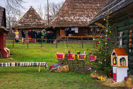 Uzhgorod, Ukraine - Jan 13, 2018: Vasylya festival celebrating in Museum of Folk Architecture and Life. representatives from different region show their cultural features