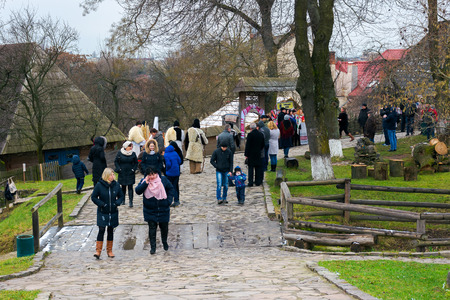 Uzhgorod, Ukraine - Jan 13, 2018: Vasylya festival celebrating in TransCarpathia. Tourists and locals hangout in Museum of Folk Architecture and Life