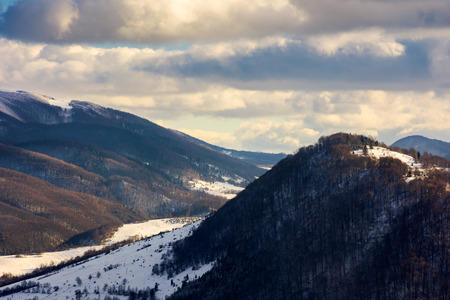 beautiful winter scenery of Carpathian mountains on a cloudy day Stock Photo