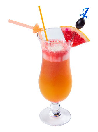 tequila sunrise cocktail in a tall glass. decorated with slice of orange and black olive