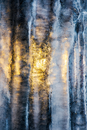 beautiful ice texture lit from behind. ice and sun, cold and warm, winter and spring resistance concept Stock Photo
