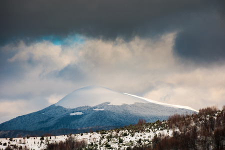 dramatic sky above the distant snowy peak. beautiful winter scenery Stock Photo
