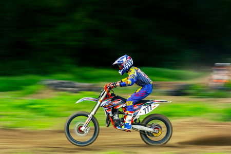 Uzhgorod, Ukraine - JUN 26, 2018: TransCarpathian Open Regional Motocross Championship. extreme sport competition. panning with slow shutter speed, motion blur effect.