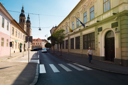 Sibiu, Romania - JUL 25, 2017: Places of interest on Mitropoliei street in Sibiu. The National Bank of Romania and Holy Trinity Cathedral in the distance. great travel destination and summer vacation