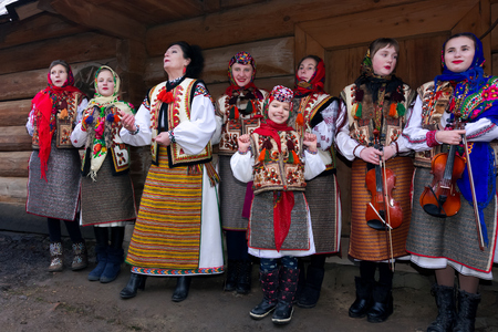 Uzhgorod, Ukraine - Jan 13, 2018: Vasylya festival celebrating in Museum of Folk Architecture and Life. Group of kids in traditional suits singing hutsul carols