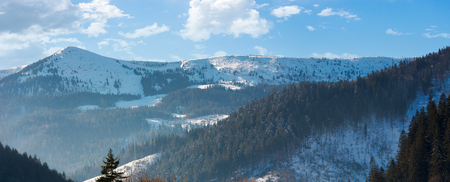 panorama of mountain ridge and forested hills. lovely winter scenery