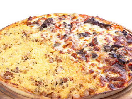 double topping pizza for couples on the wooden desk isolated close up. cheese and chicken vs beef and tomato, find your favorite