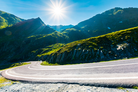 Transfagarasan road in mountains winding uphill. popular travel destination of Romania. beautiful summertime weather Stock Photo - 113389624