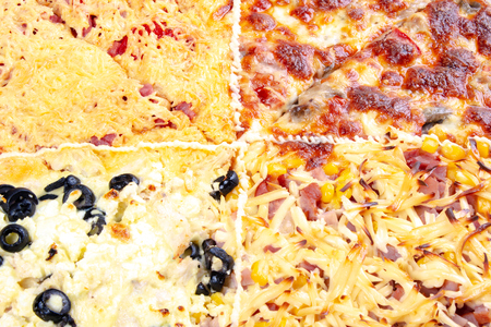 quadruple topping family pizza closeup. sausage vs pork and corn vs mushrooms vs olives, in different kind of cheese. find your favorite Stock Photo