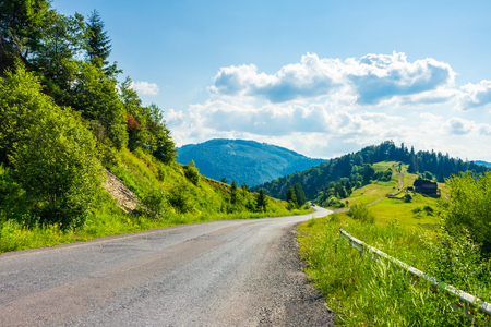 road through rural area in mountains. beautiful summer landscape. travel concept Stock Photo