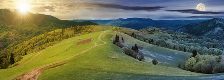 panorama of night and day time change above countryside. path down the grassy rural hills rolling in to the distance. ridge beneath an overcast sky with sun and moon in spring