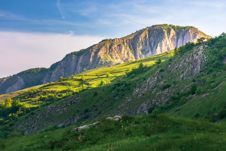 beautiful landscape of romania mountains. springtime nature at sunrise. distant cliff in morning light Stock Photo