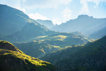 fagaras mountain ridge in the morning. rocky formations in sunlight. beautiful summer scenery Stock Photo