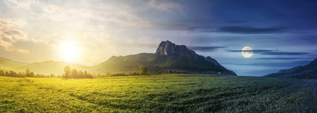 time change concept above panorama of romania countryside with sun and moon. beautiful scenery with trees in haze on a grassy field. huge rocky cliff above the forested hill in the distance.