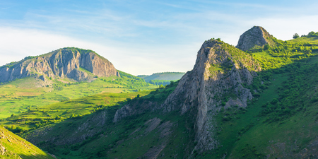 panorama of a beautiful mountain landscape. huge rocky formations on top of a rolling hills. wonderful springtime scenery at sunrise