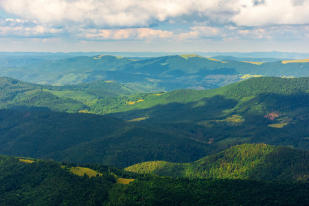 mountains and valleys of Carpathians. beautiful view of Beskid massif in summertime. water dividing ridge in the distance