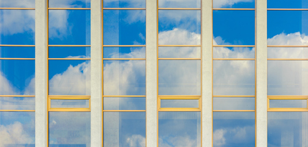 beautiful urban architecture panoramic background. window reflection of a clouds on a blue sky. Stock Photo