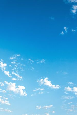 beautiful summer sky background. lots of white fluffy clouds on the blue sky. vivid nature background. calm and sunny weather Stock Photo