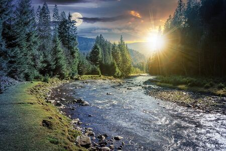 day and night time change concept above mountain river in forest. beautiful nature scenery in autumn. spruce trees by the shore. synevyr national park landscape with sun and moon