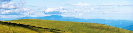 panorama of the mountain range. beautiful summer landscape on the windy and cloudy day.