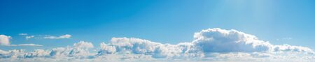 amazing cloud formations on a bright blue sky. beautiful side lit cloudscape panorama in springtime