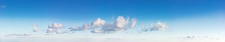 beautiful cloudscape in evening light. fluffy clouds on the blue sky. panoramic picture useful for compositing Stock Photo