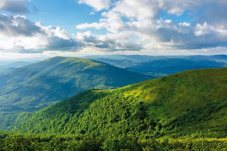 summer afternoon in mountains. wonderful landscape of green carpathian. beautiful fluffy clouds on a blue sky above the ridge. travel freedom concept. Stock Photo - 130705839